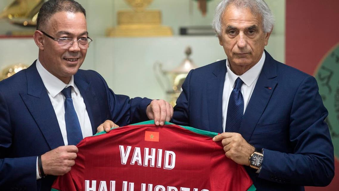Bosnian coach Vahid Halilhodzic poses with Fouzi Lekjaa (L), President of Morocco's Royal Football Federation (FRMF), after signing on as the new coach of the Moroccan national football team during a press conference in the capital Rabat on August 15, 2019. (AFP)