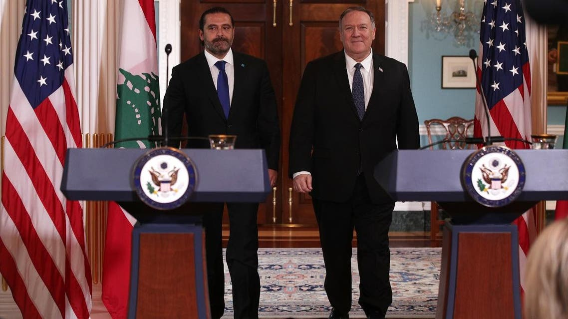 US Secretary of State Mike Pompeo shakes hands with Lebanese Prime Minister Saad Hariri after they spoke to members of the media at the State Department on August 15, 2019, in Washington, DC. (AFP)