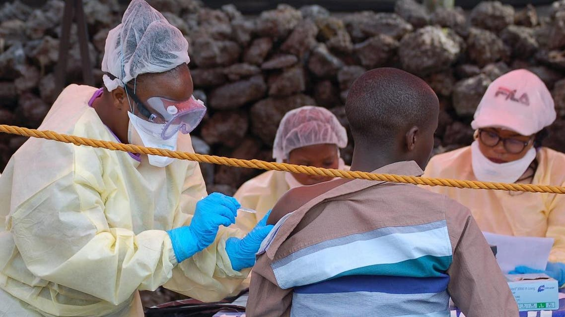A young man receives a vaccine against Ebola from a nurse in Goma on August 7, 2019. (AFP)