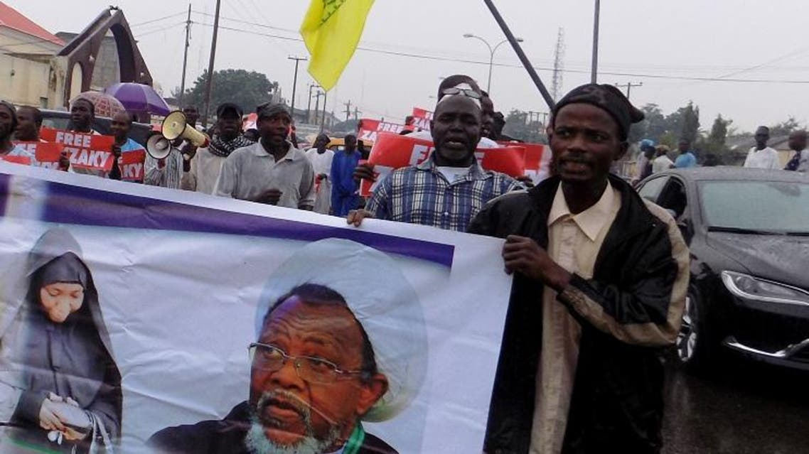 Protesters from the pro-Iranian Islamic Movement in Nigeria (IMN) carry banners calling for the release of their leader Ibrahim Zakzaky and his wife. (File photo: AFP)