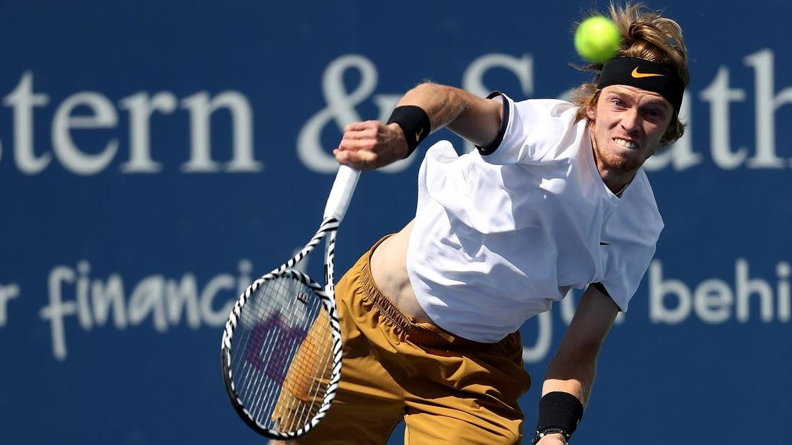 Andrey Rublev of Russia serves to Roger Federer of Switzerland during Day 6 of the Western and Southern Open at Lindner Family Tennis Center on August 15, 2019, in Mason, Ohio. (AFP)