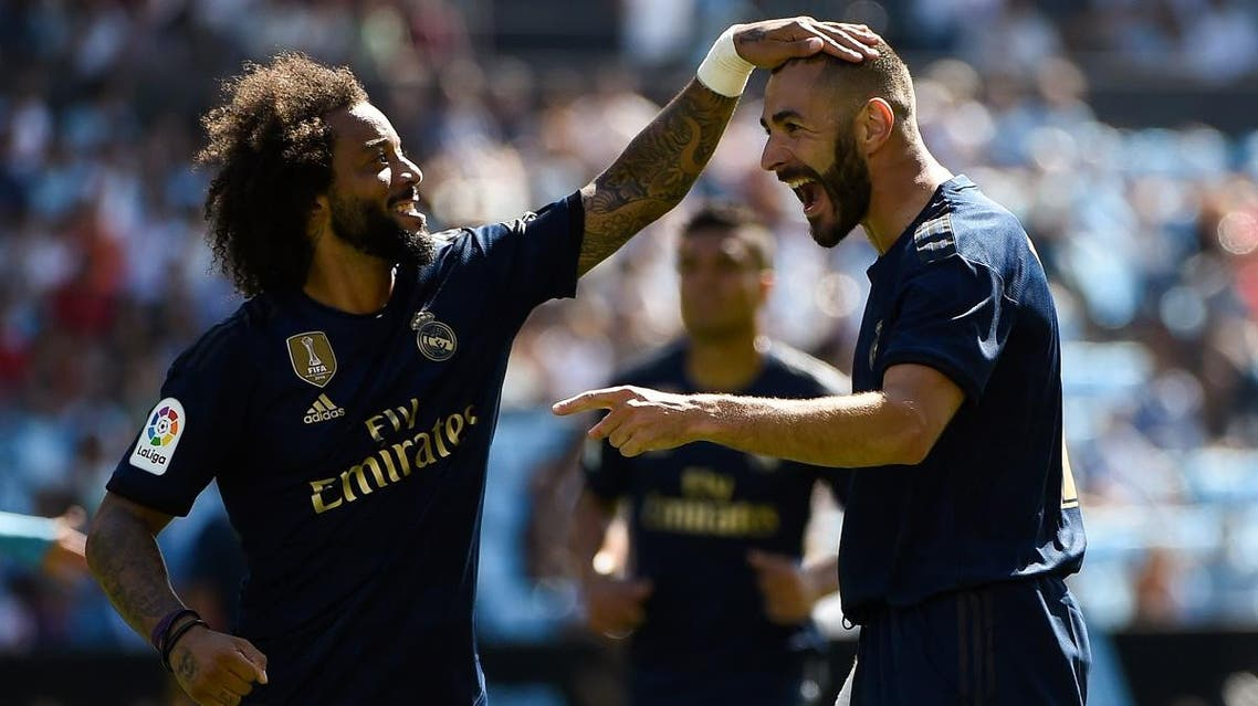 Real Madrid's French forward Karim Benzema (R) celebrates with Real Madrid's Brazilian defender Marcelo. (AFP)