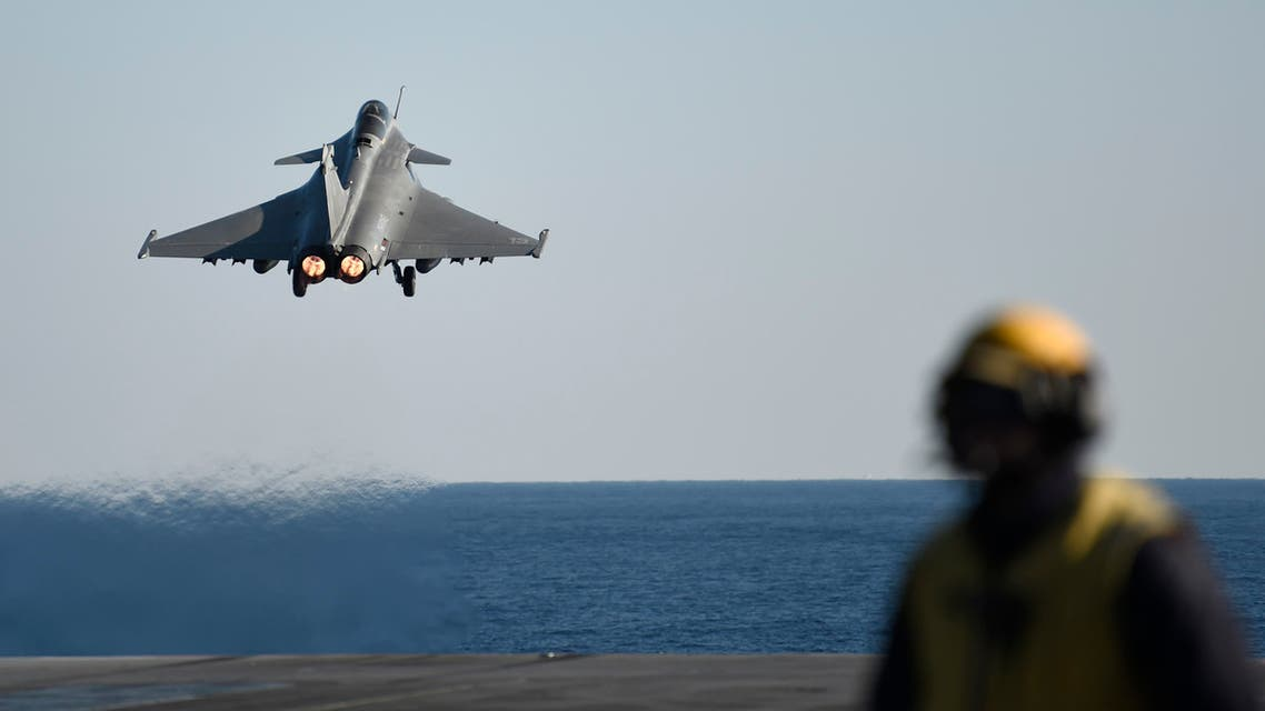A French Rafale fighter jet takes off from the deck of France's aircraft carrier Charles-de-Gaulle operating in the eastern Mediterranean Sea on December 9, 2016, as part of an international coalition against the Islamic State (IS) group.