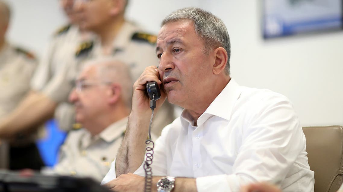 A handout picture taken and released on May 28, 2019 by the Turkish Defence Ministry shows Turkish Chief of General Staff Hulusi Akar conducting a counter-terror operation in Northern Iraq's Hakurk district with the attendance of Commander of the Turkish Land Forces Yasar Guler (not seen) and other commanders during night time in Ankara.