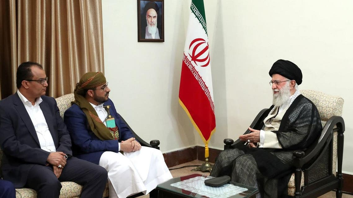 A handout picture provided by the office of Iran's Supreme Leader Ayatollah Ali Khamenei on August 13, 2019 shows him (R) meeting with Mohammed Abdul-Salam (2nd-L), spokesman for Yemen's Houthis. (AFP)