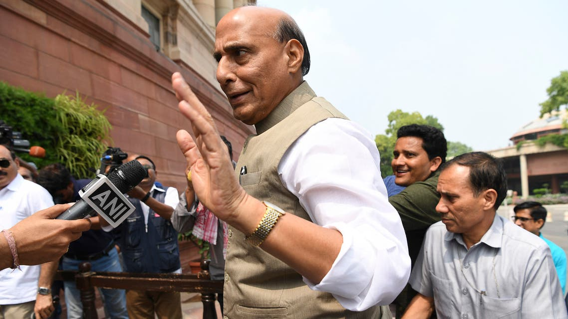 Indian Defence Minister Rajnath Singh (C) arrives at the Parliament House in New Delhi on August 5, 2019.