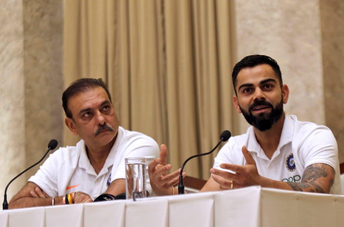Indian cricket team coach Ravi Shastri (left), looks on as captain Virat Kohli addresses a press conference  in Mumbai, India. (File photo: AP)