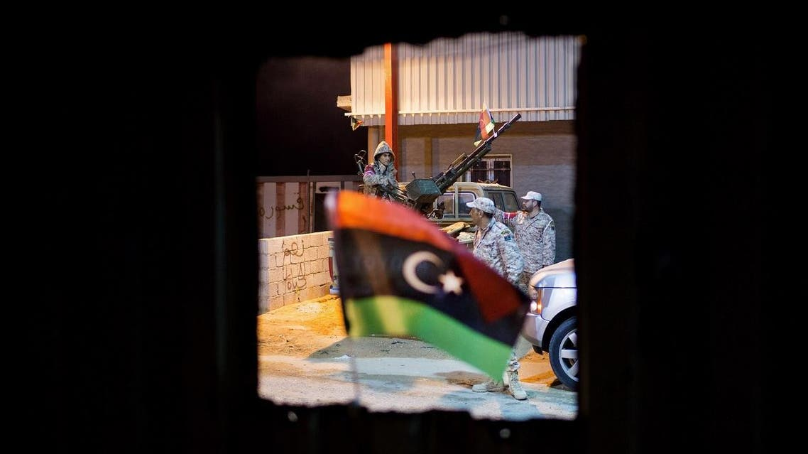 In this Wednesday, Feb. 18, 2015 photo, Libyan military soldiers stand guard, east of the city of Misrata, Libya. (AP)