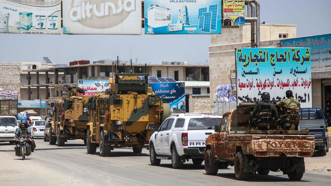 Turkish military vehicles drive in a convoy along the Bab al-Hawa highway on May 21, 2019 on their way to reinforce Turkish military observation points in the southern countryside of Syria's Aleppo province.