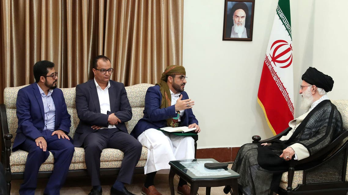 A handout picture provided by the office of Iran's Supreme Leader Ayatollah Ali Khamenei on August 13, 2019 shows him (R) meeting with Mohammed Abdul-Salam (C), spokesman for Yemen's Huthi rebels, during their meeting at Khamenei's residence in the capital Tehran.
