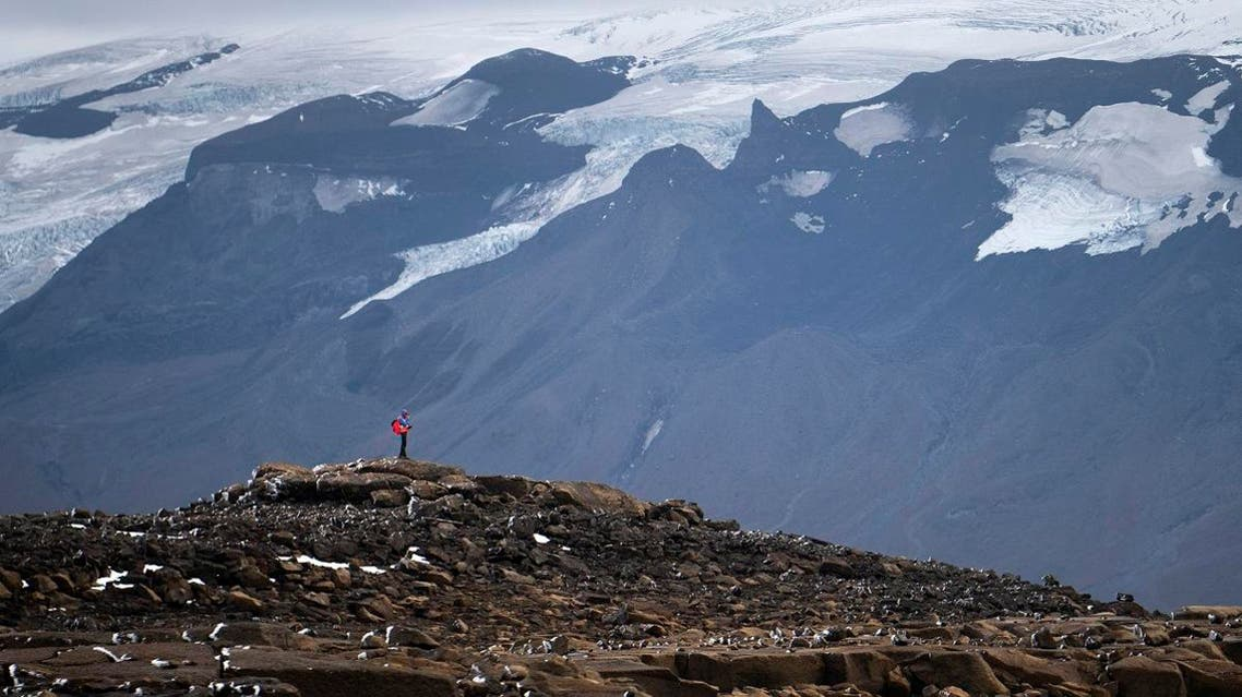 A man stops on his way to the top of what once was the Okjokull glacier, in Iceland. (AP)