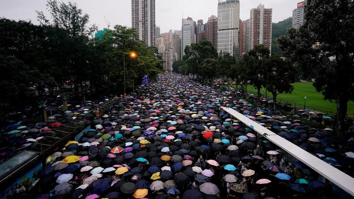 Anti-extradition bill protesters march to demand democracy and political reforms, in Hong Kong. (Reuters)