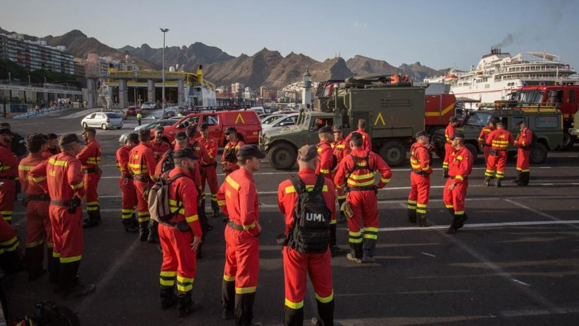 Members of the Spanish Army Emergency Military Unit prepare to travel by boat from Tenerife to the island of Gran Canaria to participate in the extinction of a new forest fire in the town of Valleseco on August 17, 2019. AFP