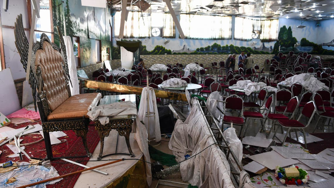 Afghan men investigate in a wedding hall after a deadly bomb blast in Kabul on August 18, 2019. (AFP)