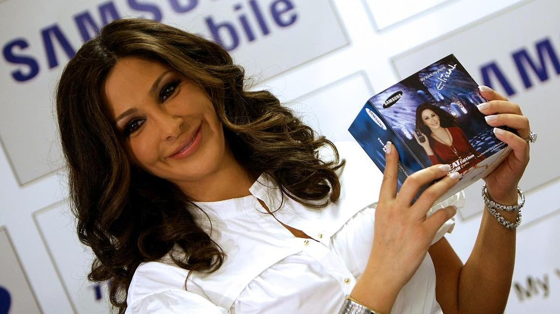 Lebanese singer Elissa promotes a Samsung product at the annual GITEX information technology fair in Dubai on October 20, 2008. (AFP)