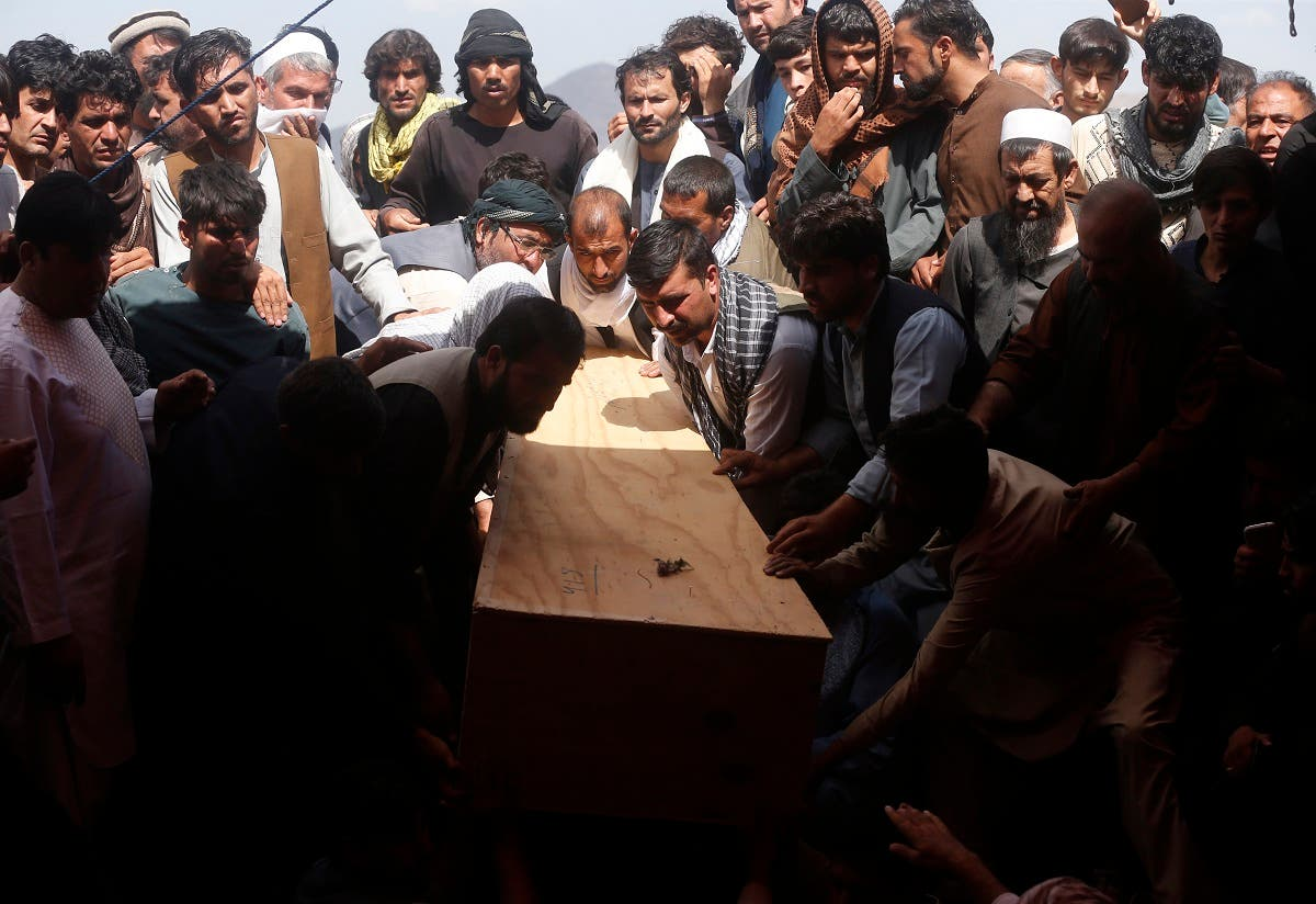 Afghans carry the body of a victim of the Dubai City wedding hall bombing during a mass funeral in Kabul, Afghanistan, on Aug.18, 2019. (AP)