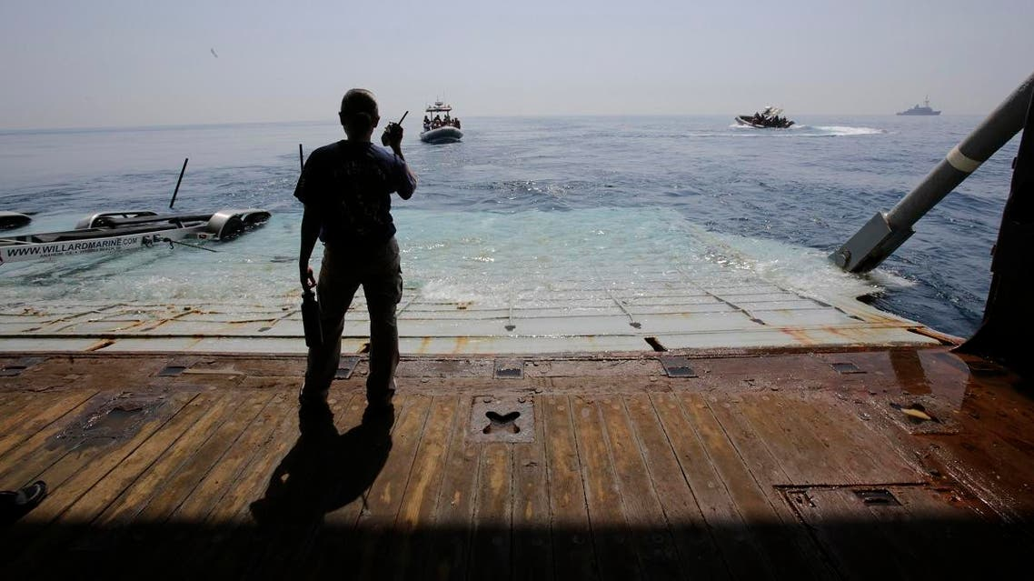 A US Navy sailor assists during training exercises with small boats coming and going from the USS Ponce. (File photo: AP)