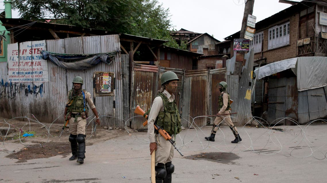 Indian paramilitary soldiers stand guard during security lockdown in Srinagar, Indian controlled Kashmir. (AP)