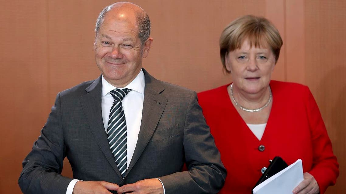 German Finance Minister Olaf Scholz (left), and German Chancellor Angela Merkel (right), arrive for the weekly cabinet meeting at the Chancellery in Berlin, Germany, on June 19, 2019. (AP)