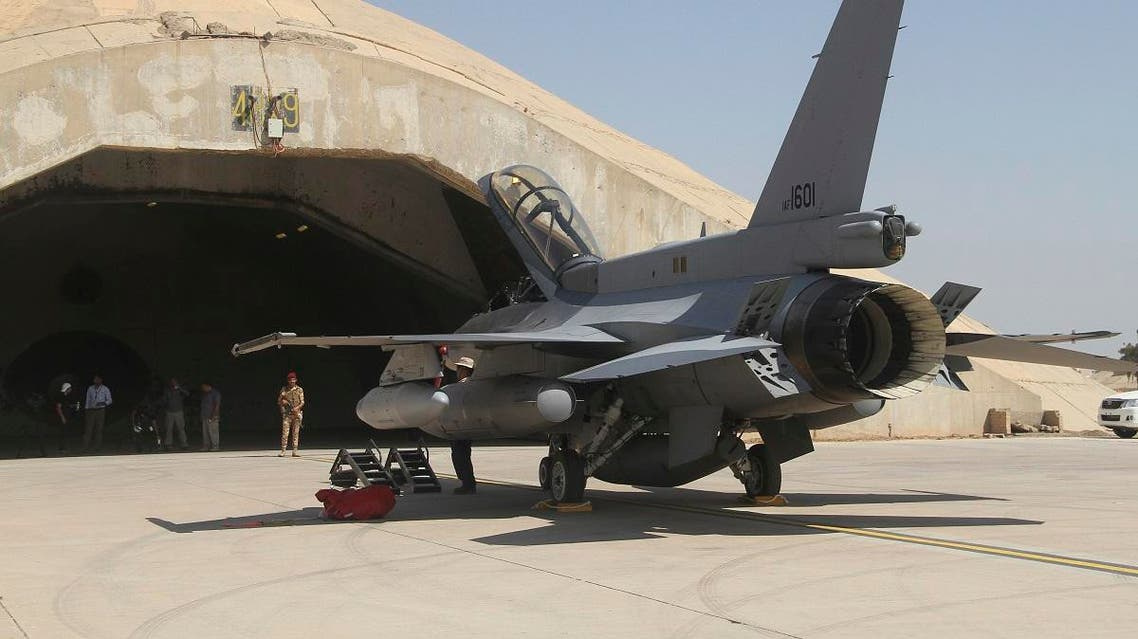 This July 2015 file photo shows one of four new U.S.- made F-16 fighter jets outside a hardened hangar upon its arrival to Balad air base, north of Baghdad. (AP)