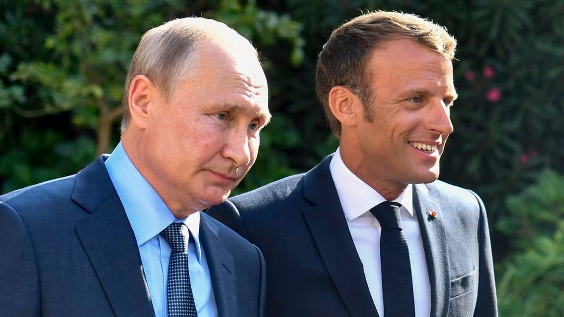 French President Macron (R) welcomes Russia's President Putin at his summer residence, the Fort de Bregancon on the French Riviera. (AFP)