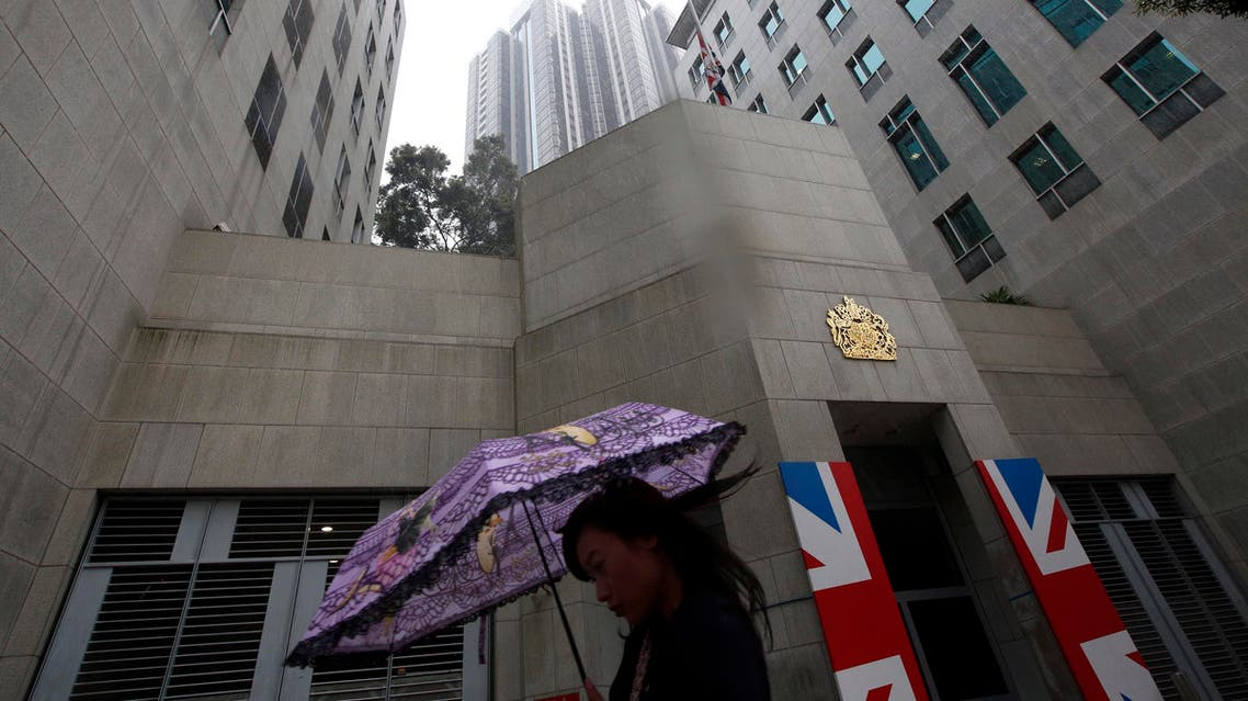 A woman walks past the British Consulate where a Union Flag is lowered to half mast in Hong Kong Tuesday, April. 9, 2013 in honor of former British Prime Minister Margaret Thatcher.  (AP)
