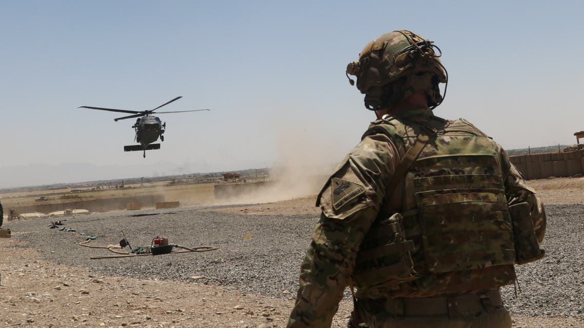 A U.S. soldier assigned to the Headquarters and Headquarters Battalion, 1st Armored Division watches as a UH-60 Blackhawk Helicopter prepares to land during an advise and assistance mission in southeastern Afghanistan, August 4, 2019. Picture taken on August 4, 2019. Courtesy Alejandro Licea/U.S. Army/Handout via REUTERS ATTENTION EDITORS - THIS IMAGE HAS BEEN SUPPLIED BY A THIRD PARTY.