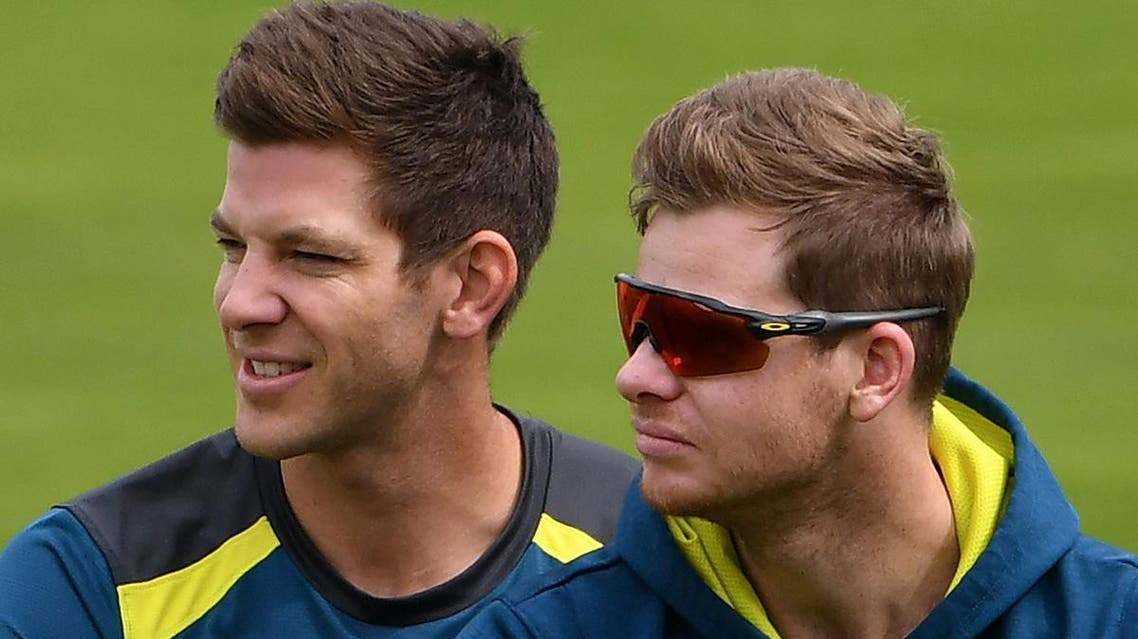 Australia's captain Tim Paine (L) and Steve Smith watch teammates during a practice session at Headingley Stadium in Leeds, northern England, on August 21, 2019 on the eve of the start of the third Ashes cricket Test. (AFP)