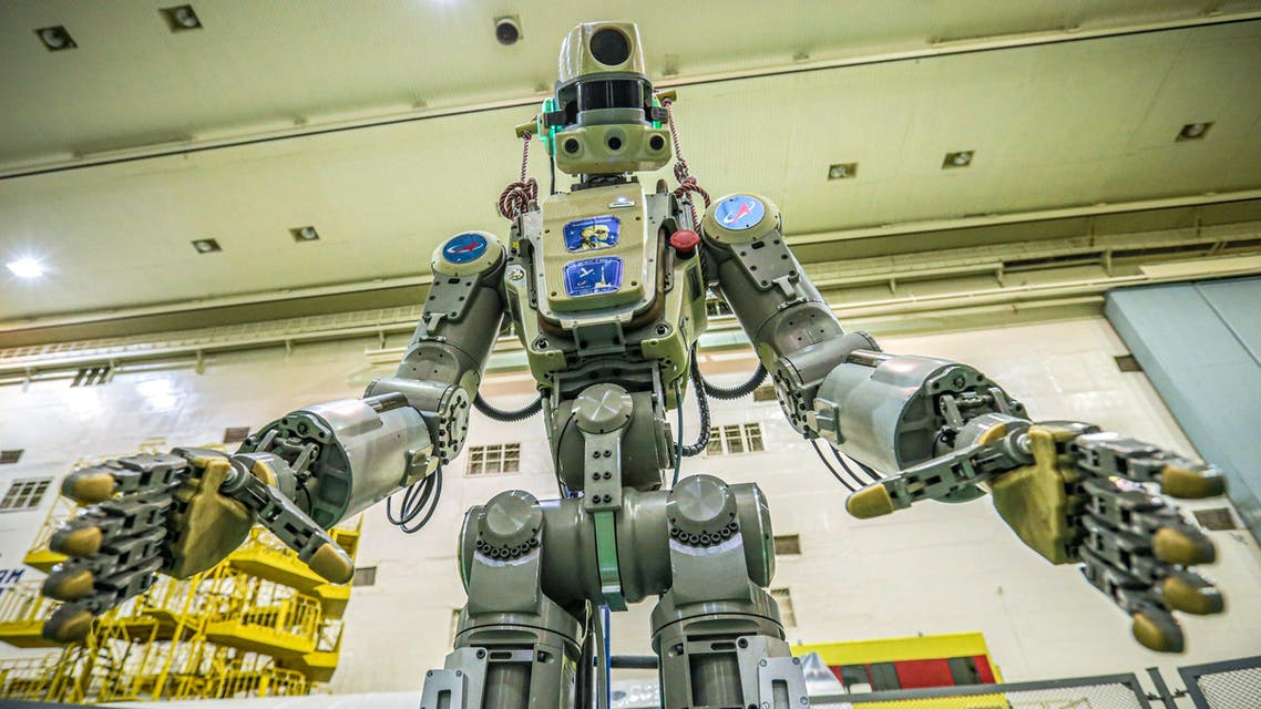 This handout picture taken on July 26, 2019 and released by the official website of the Russian State Space Corporation ROSCOSMOS on August 21, 2019 shows Russian humanoid robot Skybot F-850 (Fedor) being tested ahead of its flight on board Soyuz MS-14 spacecraft at the Baikonur Cosmodrome in Kazakhstan. (AFP)