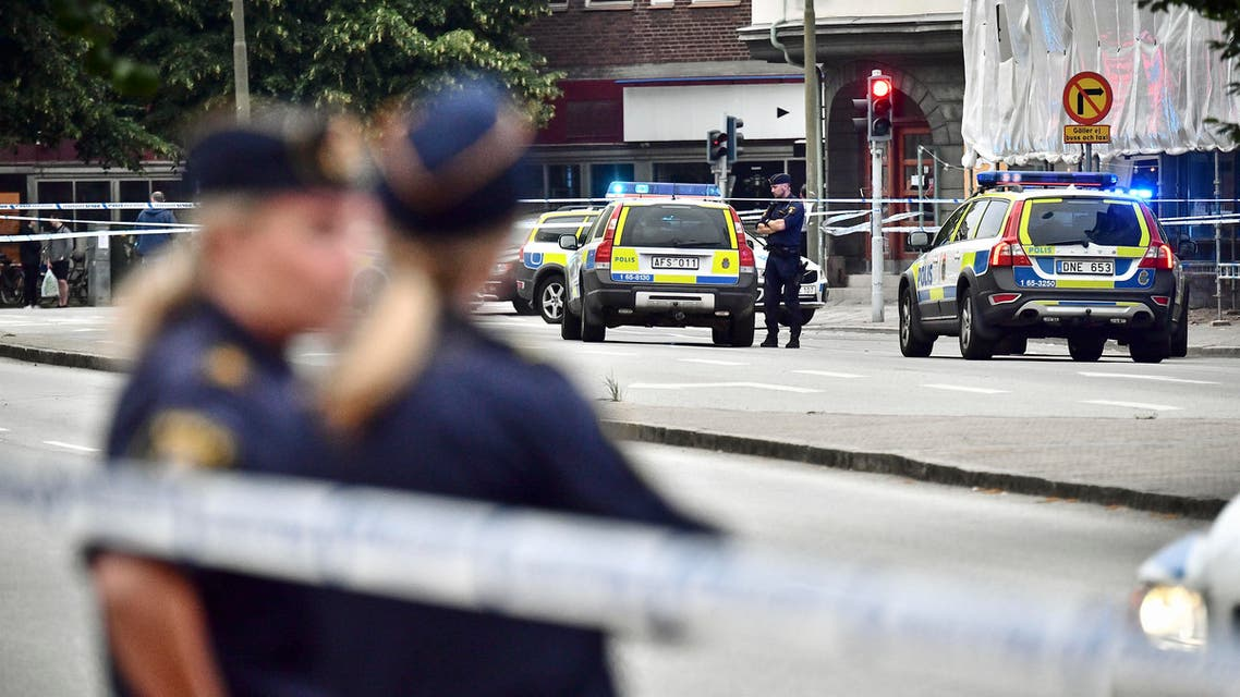 Police stand next to a cordon in central Malmo, southern Sweden, Monday, June 18, 2018. (AP)