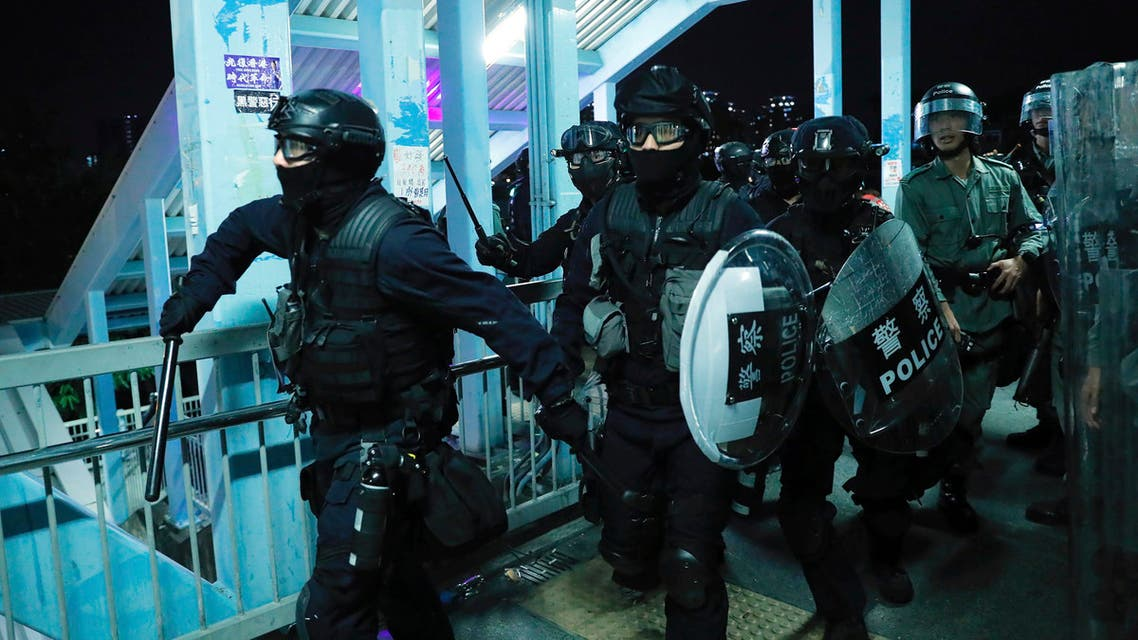Riot police gather outside the Yuen Long MTR station during a protest in Hong Kong, Wednesday, Aug. 21, 2019. (AP)