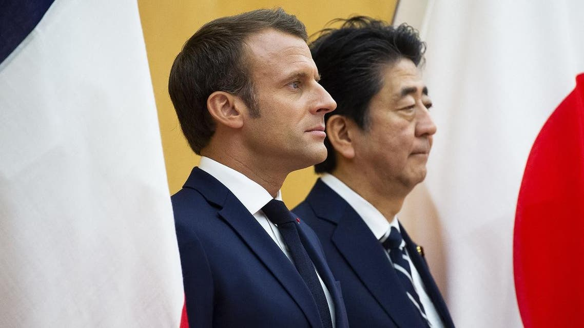 Japan's Prime Minister Shinzo Abe (center R) stands beside France's President Emmanuel Macron during an official ceremony at the prime minister's official residence in Tokyo on June 26, 2019. (File photo: AFP)