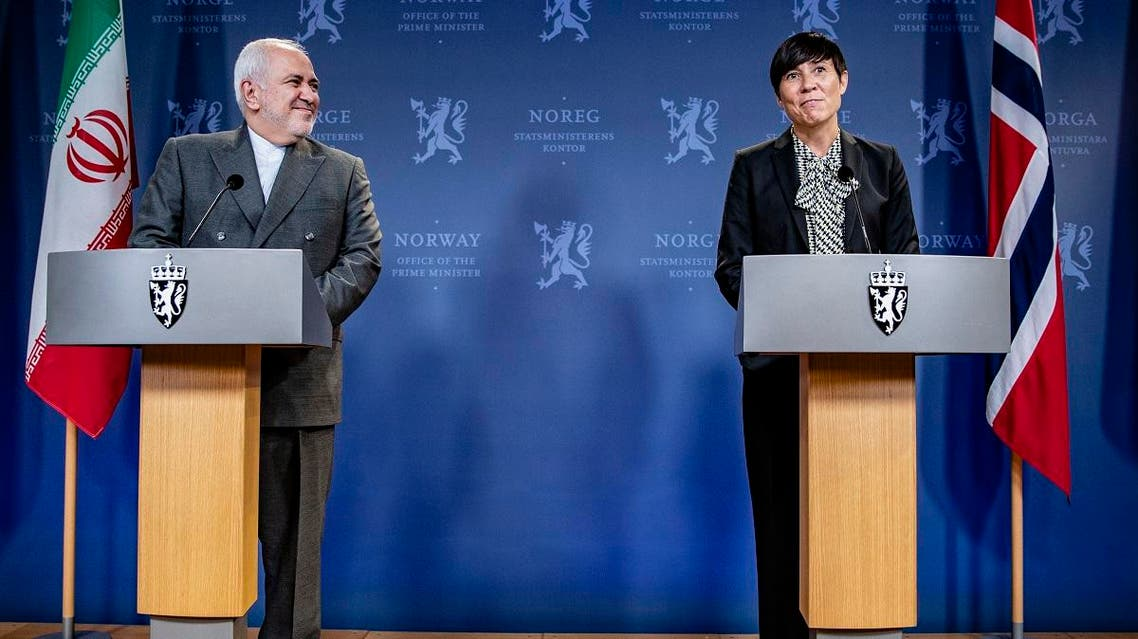 Norway's Foreign Minister Ine Eriksen Soreide and Iran's Foreign Minister Javad Zarif (L) give a joint press conference after a meeting, on August 22, 2019 in Oslo. (AFP)