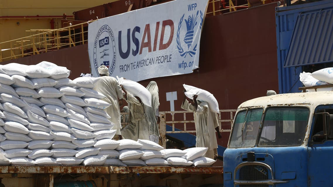 Sudanese dockers unload bags of sorgham (cereal) from one of two US ships carrying humanitarian aid supplies provided by the US development agency USAID, at Port Sudan on the red sea coast on June 5, 2018. The United States is the largest single donor to the world food program in Sudan and regularly distributes food aid to the East African country. This shipment will be distributed to over a million Sudanese who are in need of assistance.