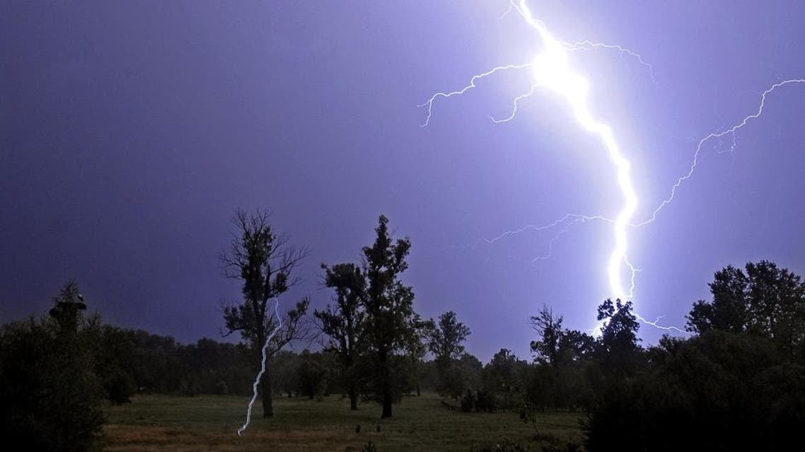 Lightning rip through the sky during a thunderstorm in the coutryside near Warsaw. (AFP)