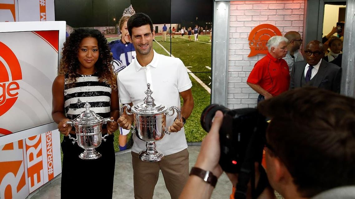 Novak Djokovic of Serbia and Naomi Osaka of Japan hold their winners trophies at NBC's TODAY Show on September 10, 2018 in New York City. (AFP)
