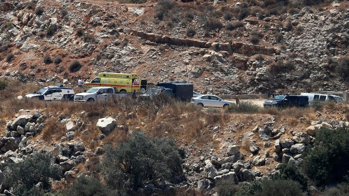 An Israeli ambulance and security forces gather at the site where a bomb was reportedly thrown from a passing car near the Israeli settlement of Dolev in the occupied West Bank on August 23, 2019 injuring at least three people. (AFP)