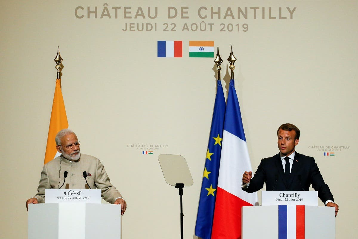French President Emmanuel Macron (R) speaks as he and Indian Prime Minister Narendra Modi deliver a joint statement after their meeting at the Chateau of Chantilly, near Paris, on August 22, 2019.  (AFP)