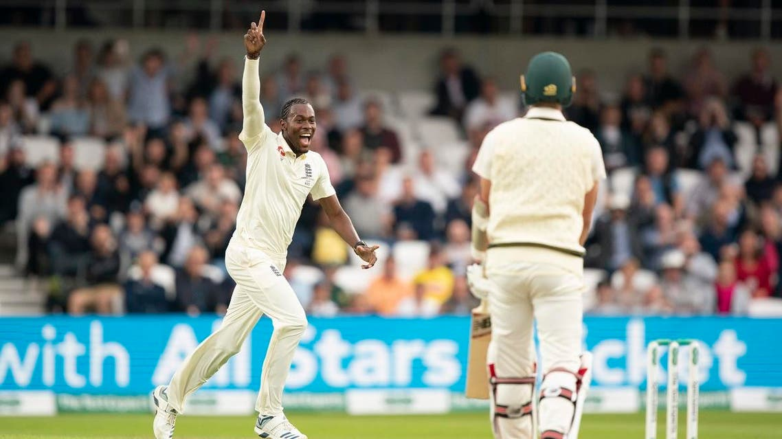 England's Jofra Archer celebrates after taking his 5th wicket, that of Australia's Pat Cummins, (right), caught by Jonny Bairstow for 0 on the first day of the 3rd Ashes Test at Headingley in Leeds, England, on August 22, 2019. (AP)