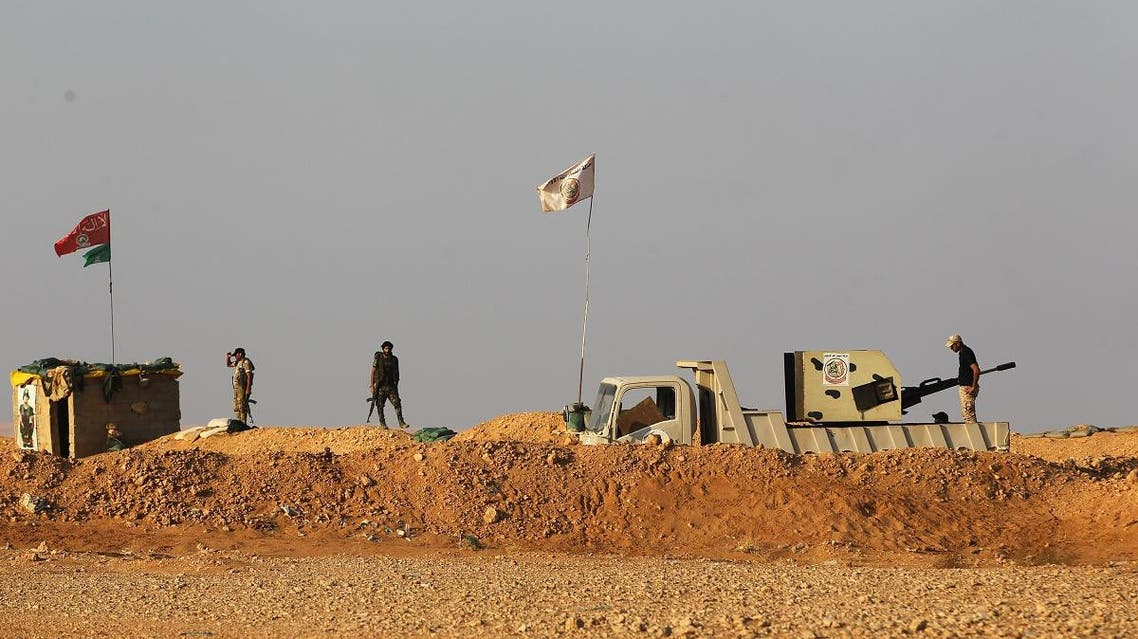 Iraqi Shiite fighters of the Hashed al-Shaabi paramilitary force secure the border area with Syria in al-Qaim in Iraq's Anbar province. (File photo: AFP)