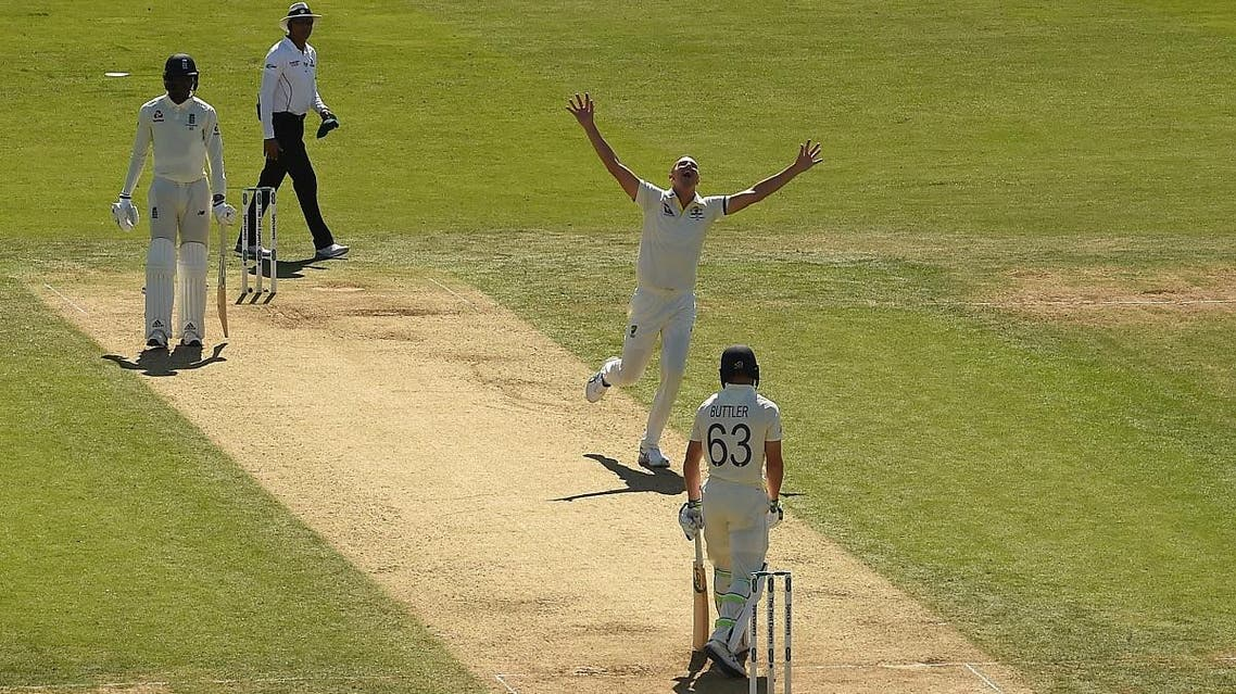 Australia's Josh Hazlewood (C) celebrates taking the wicket of England's Jos Buttler (R) during the second day of the third Ashes cricket Test match at Headingley in Leeds, northern England, on August 23, 2019. (AFP)