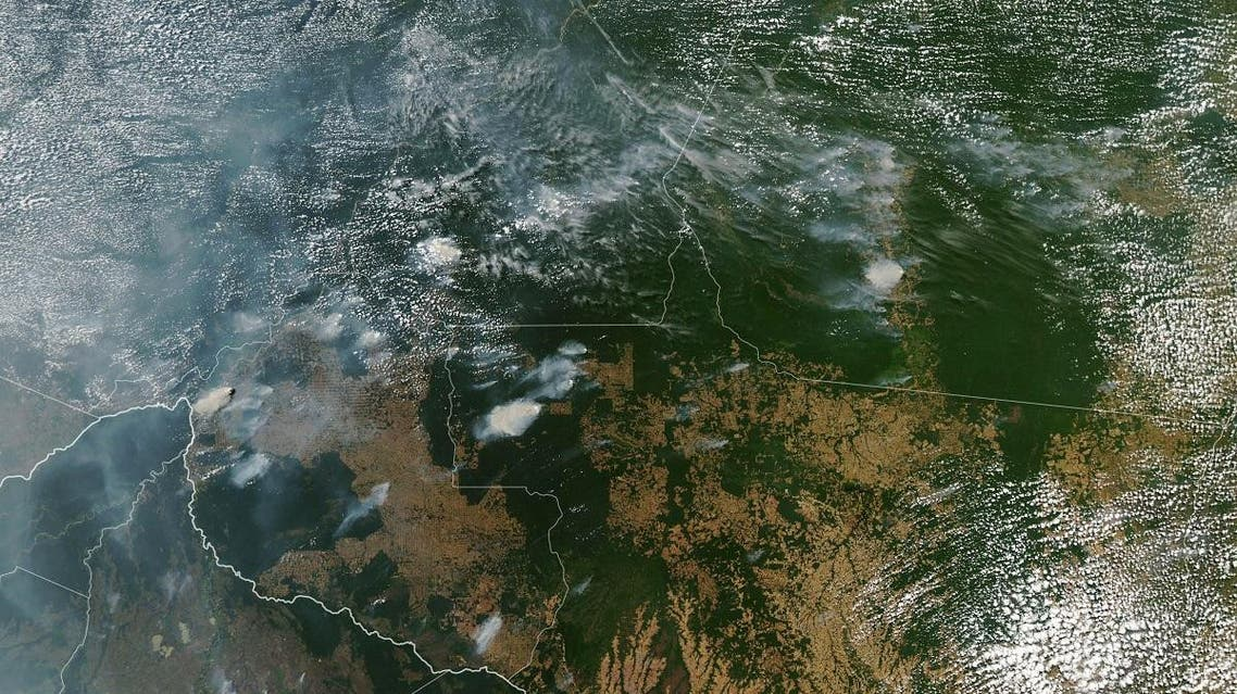A NASA Earth Observatory image shows several fires burning in the Brazilian states of Amazonas on August 11, 2019, while Bolivia appears on the left bottom of the image. (AFP)