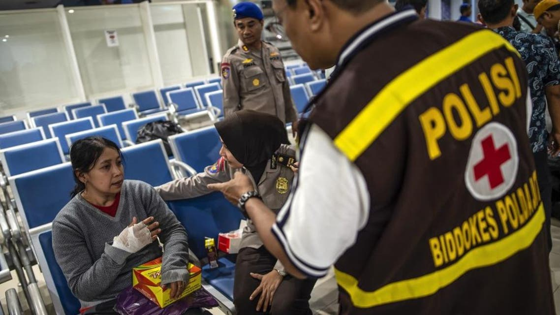 A passenger of a ferry that caught fire receives a medical treatment after being evacuated, at Tangjung Perak seaport, in Surabaya, East Java, on August 23. (AFP)