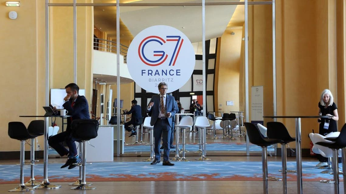 People work in the advanced press centre in the Casino of Biarritz, south-west France on August 24, 2019, on the first day of the annual G7 Summit attended by the leaders of the world's seven richest democracies, Britain, Canada, France, Germany, Italy, Japan and the United States. (AFP)