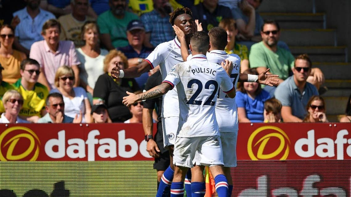 Chelsea's English striker Tammy Abraham (L) celebrates with teammates after scoring his second goal on August 24, 2019. (AFP)