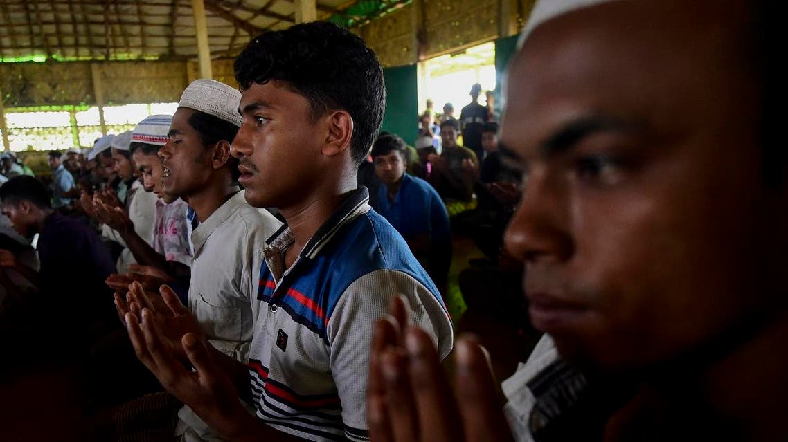 Rohingya Muslim refugees offer their Friday prayers at a mosque in the Kutupalong refugee camp in Ukhia district in Bangladesh on August 23, 2019. (AFP)