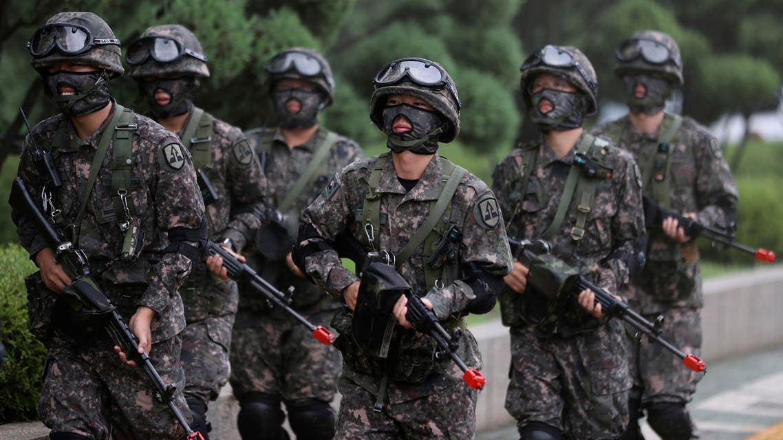 South Korean army soldiers walk after an anti-terror drill as a part of Ulchi Freedom Guardian exercise at National Assembly in Seoul, South Korea, Wednesday, Aug. 23, 2017. (AP)