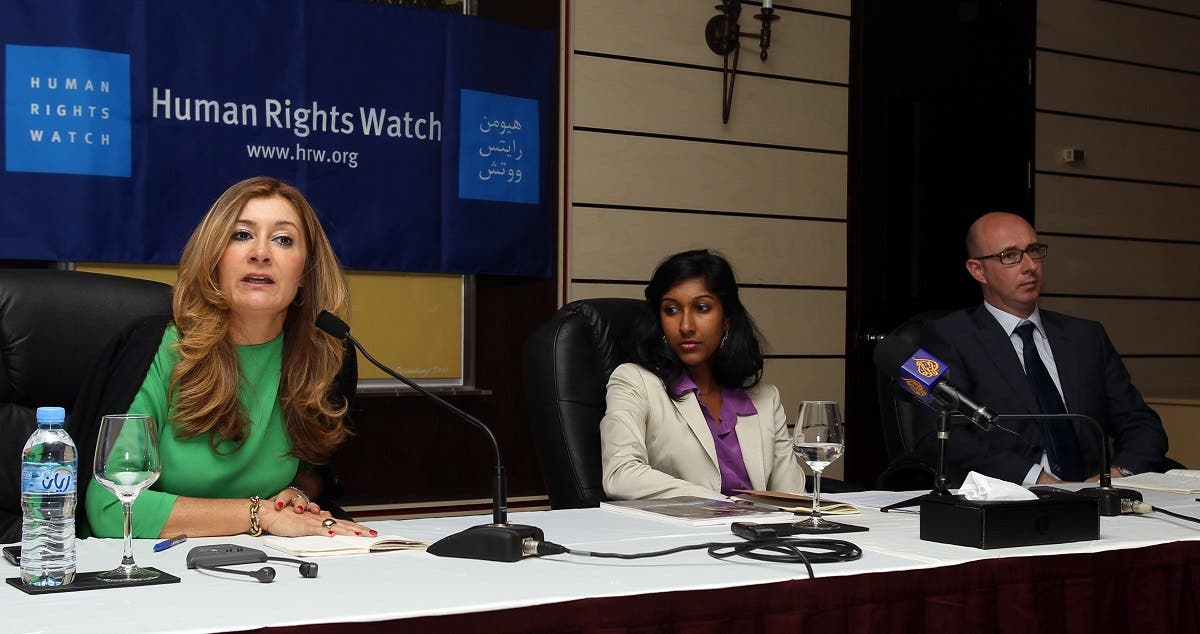Human Rights Watch (HRW) Middle East and North Africa (MENA) director Sarah Leah Whitson (L), Priyanka Motaparthy (C), a representative of the MENA division of HRW and Nicholas McGeehan (R), the director of Mafiwasta, an organisation for workers' rights in the United Arab Emirates, attend a press conference in Doha on June 12, 2012. (AFP)