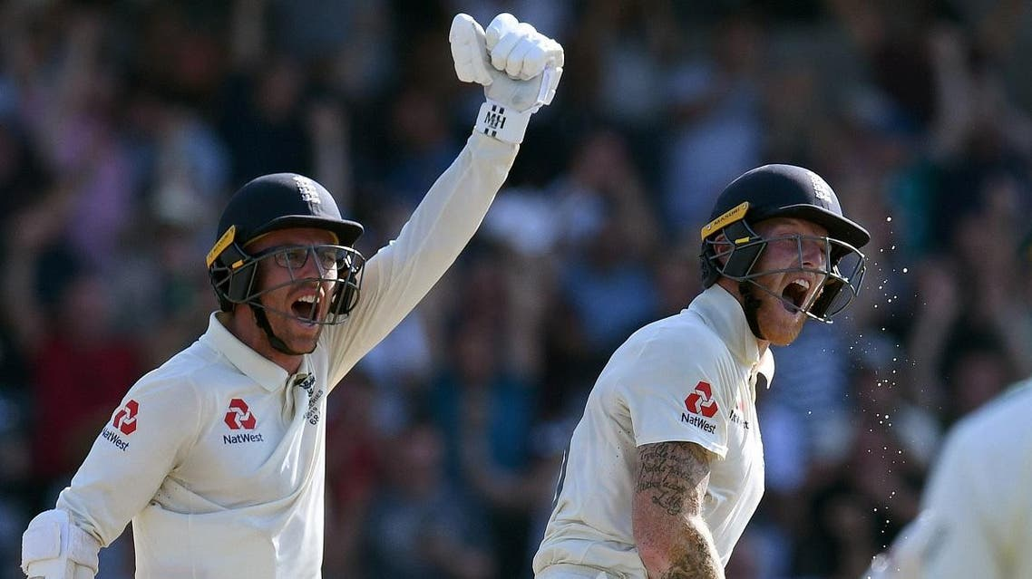 England's Ben Stokes (R) and England's Jack Leach react after England won the third Ashes cricket Test match between England and Australia at Headingley in Leeds, northern England, on August 25, 2019. (AFP)