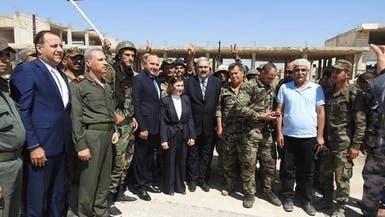 فجأة.. مستشارة الأسد في خان شيخون وسط حراسة مشددة